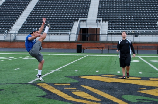 Coach Jackson working with NFL Senior Bowl Punter Cody Mandell